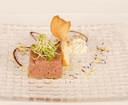 Beef tartare with mustard and chives served with bread wafer