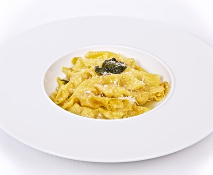 Homemade casoncelli flavored with butter and sage