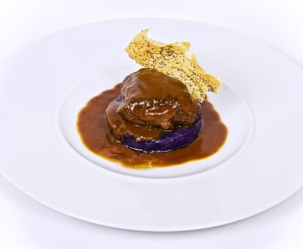 Soft veal cheek with violet potatoes and vegetables sauce