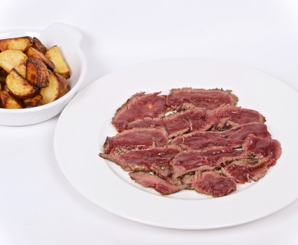 Sliced meat Villa Fenaroli style served with baked potatoes