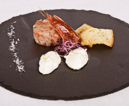 Prawn crudité dressed with marjoram, extravirgin olive oil and mozzarella cheese